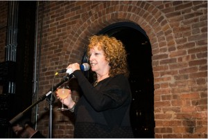 Susan Feldman, president of St. Ann's Warehouse, speaks at the after party. Photo by Rob Abruzzese