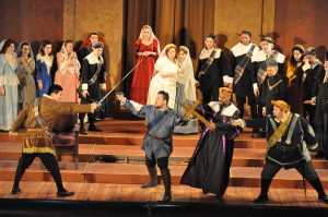 Edgardo (Benjamin Sloman, center) crashes the wedding, leading to a sword fight. Photo by George Schowerer
