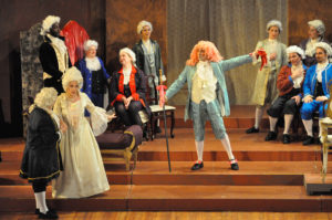 After having danced a minuet with the dancing master (Reuven Aristigueta, in pink wig), Manon (Sabrina Palladino,in white gown) flirts with the elderly Geronte (John Schenkel, far left with back to the audience).