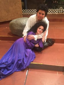 Des Grieux (Percy Martinez) holds the dying Manon (Sabrina Palladino).