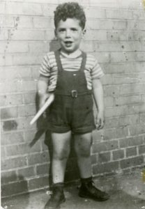 Elliott Gould, 3 years old, with a space-gun, outside back wall of local movie theater. Photo courtesy of Elliott Gould