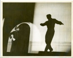Elliott Gould as bellboy at the Palace Theater, NYC, watching Bill Callahan (dancer in silhouette). Photo courtesy of Elliott Gould