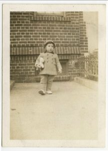 Elliott Gould with teddy bear, in front of 6801 Bay Parkway, early 1940s. Photo courtesy of Elliott Gould