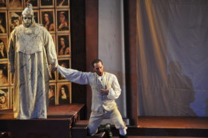 Don Giovanni (Nathan Matticks, right) is held by the Commendatore's statue (Antoine Hodge) refusing to repent for his sins. Photo by George Showerer.