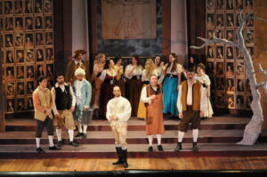 Don Giovanni (center, in white) surrounded by villagers. Photo by George Showerer.