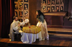 Don Giovanni (Nathan Matticks, seated) is interrupted during dinner by Donna Elvira (Zhanna Alkhazova, right) Photo by George Schowerer